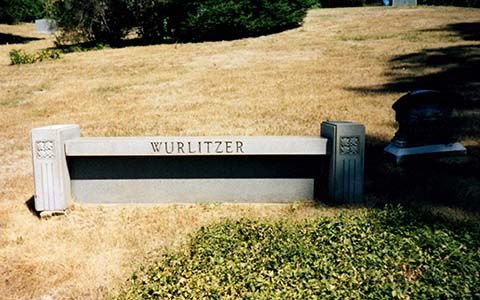 Stone bench engraved with the Wurlitzer name and overlooking the Wurlitzer family gravesites.