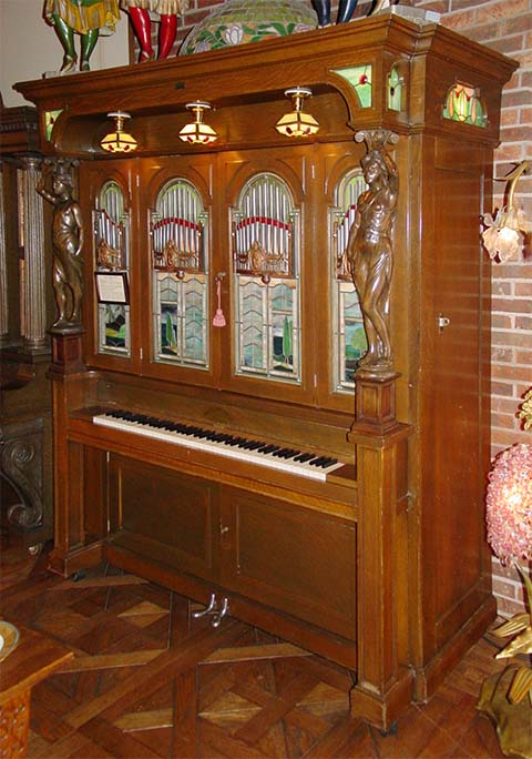 Cremona Style F piano with pipes.
