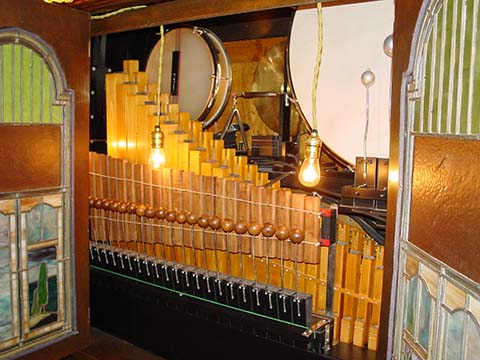 Interior of Cremona Style F piano with pipes.