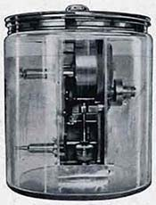 Catalogue illustration of a Metronome Moter in a large glass jar and fully submerged in water.