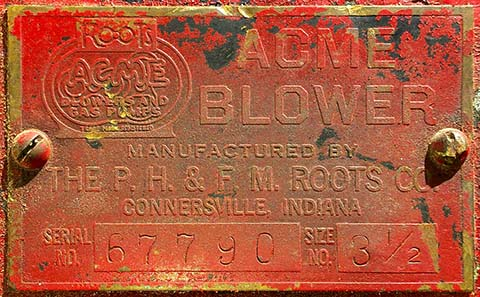 Nameplate for an Acme Blower made by the Roots Company.