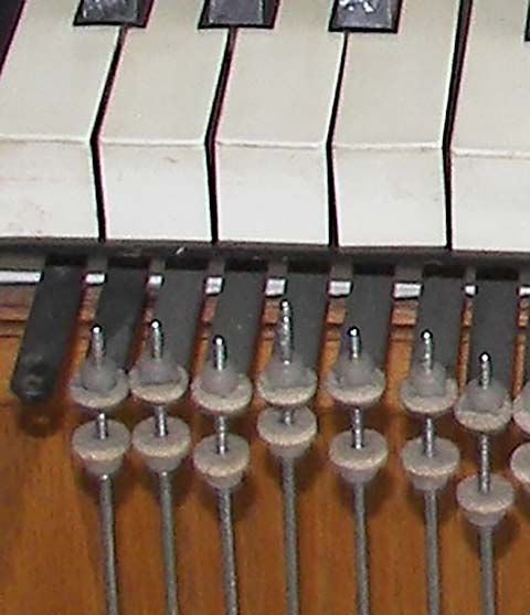 Close-up of key levers and adjustment nuts for key connector rods.