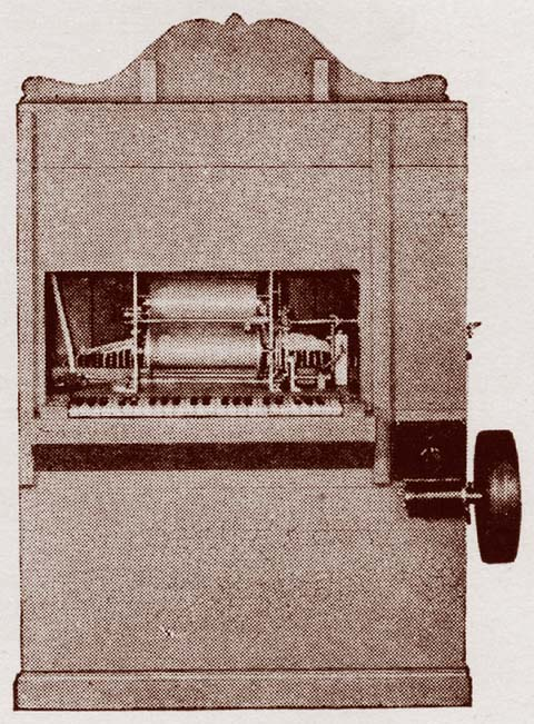 Rear View showing roll arrangement for playing automatically.