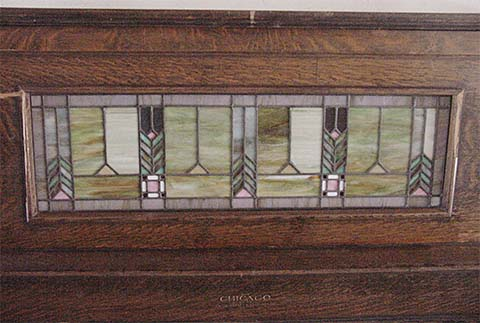 Art glass panel in Chicago Electric EL-1 piano.