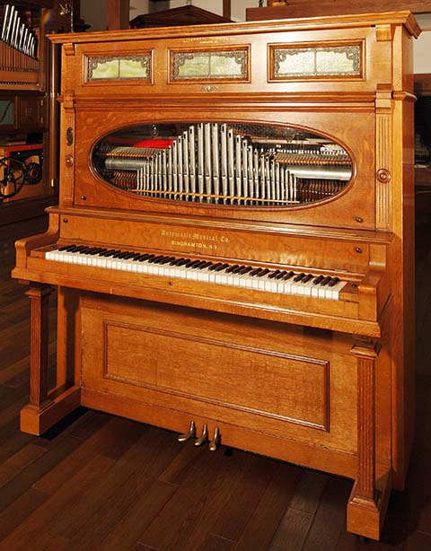 Automatic Musical Company transitional piano with metal flute pipes.