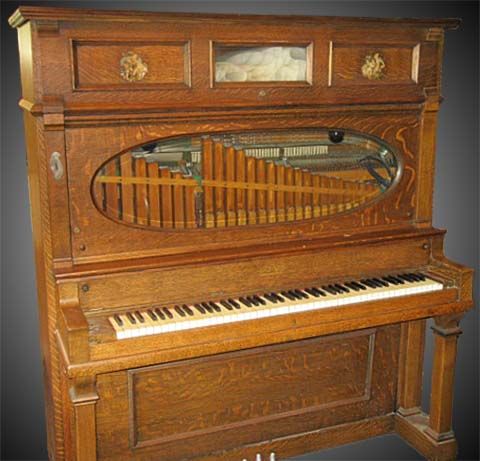 Automatic Musical Company piano with wooden flute pipes.