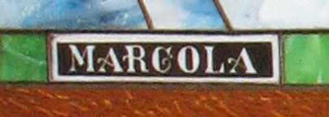 Close-up of the Marcola brand on an art glass panel.