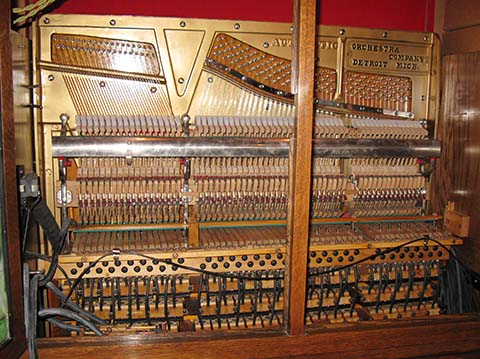 Upper interior of the Marcola cabinet style flute piano.
