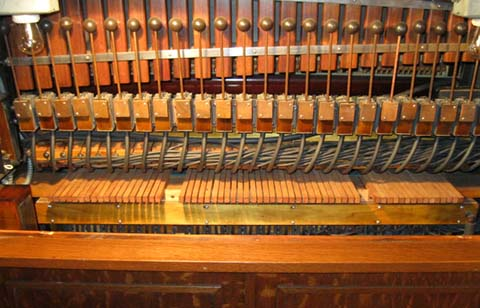 Late Link 2EX keyboardless cabinet piano that is fitted with a tuning keyboard.