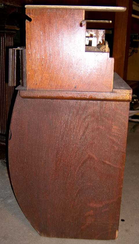 Side view of a music roll bin for an early Automatic Musical Company music roll mechanism.