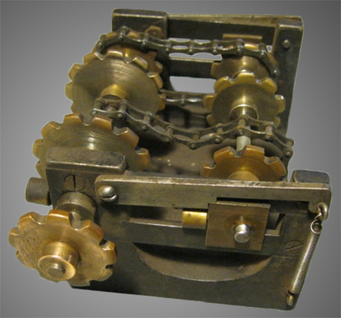 Link chain-drive speed transmission for the MP Jr. four roll mechanism system.