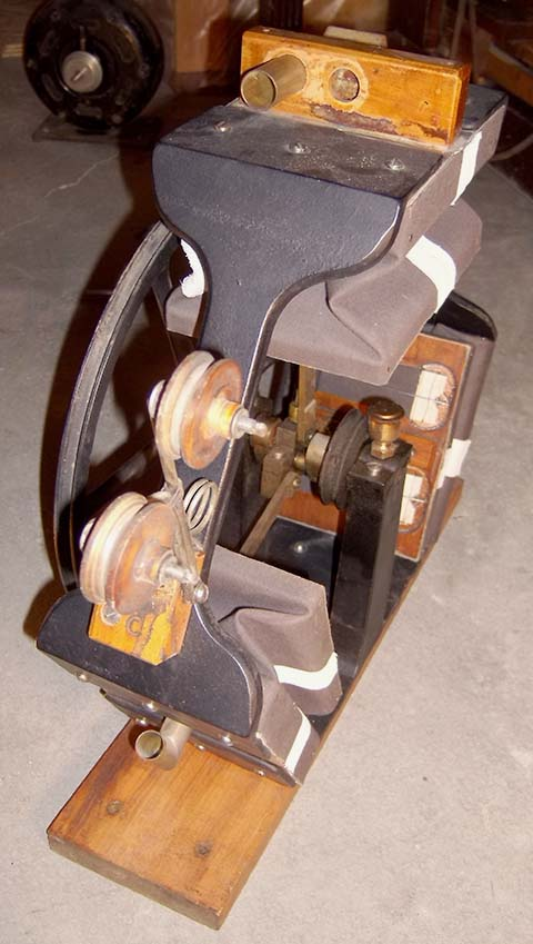 Side view of an early 3-lobe rotary pump that has been removed from the bottom of an Automatic Musical Company coin piano.