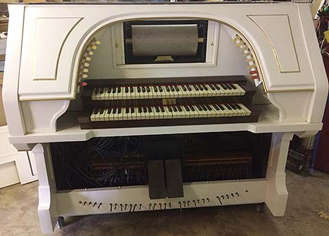 Reproduco Unified Mortuary Organ console finished in white and gold.