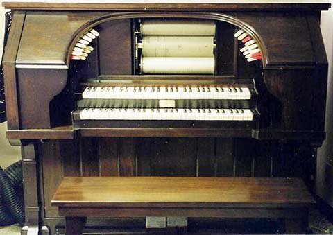Reproduco Unified Theatre Organ console in a mahogany case.
