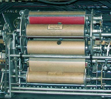 Six station Wurlitzer Automatic Roll changer loaded with rolls.