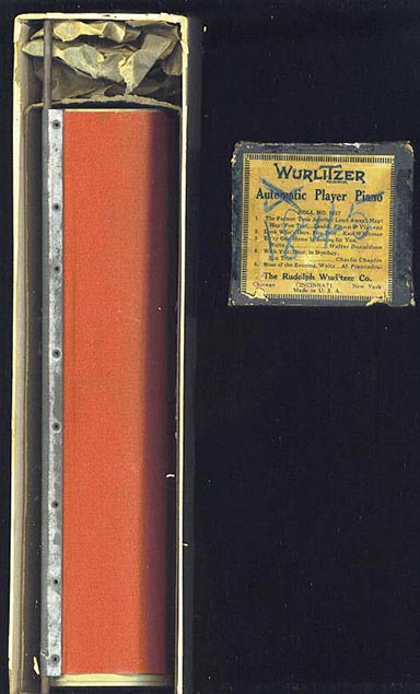 Wurlitzer APP boxed green paper 5-tune roll for a Wurlitzer automatic roll changer.