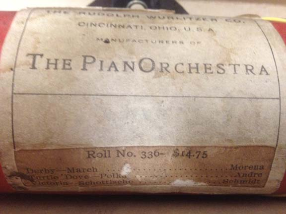 An early PianOrchestra label with a printed tune list for roll #336 pasted onto it.