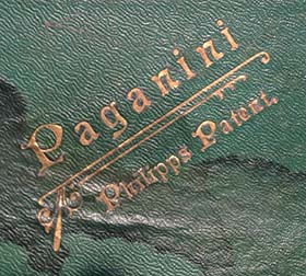 Embossed Paganini - Philipps Patent logo on the top side of a music roll box.
