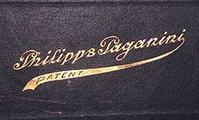Embossed Philipps Paganini - Patent logo on the top side of a music roll box.
